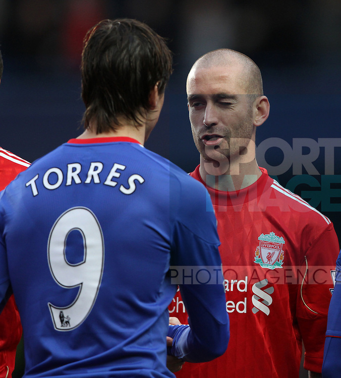 Chelseas Fernando Torred shakes hands wih Liverpools Raul Meireles