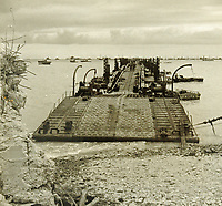 BNPS.co.uk (01202 558833)<br /> Pic: MitchellsAuctionHouse/BNPS<br /> <br /> PICTURED: Inshore end of pier being placed into position at Arromanches off the Normandy coast.<br /> <br /> The fascinating archive of one of the engineers who designed the Mulberry Harbours which were installed off the Normandy coast following the D-Day landings has come to light.<br /> <br /> Colonel Vassal Charles Steer-Webster OBE helped create the giant, floating artificial harbours which protected anchored supply ships from German attacks.<br /> <br /> They were built in the dry docks on The Thames and Clyde and pulled across the channel by tugs before being hastily assembled.<br /> <br /> Col Steer-Webster was in almost daily contact with Churchill during their development ahead of June 6, 1944. Now, his personal effects, including a letter of thanks from Winston Churchill, are being sold by his nephew with Mitchells Auctioneers, of Cockermouth, Cumbria. <br /> <br /> The archive, which is expected to fetch £15,000, also features 150 photos showing Mulberry B's construction and use, as well as his medals.