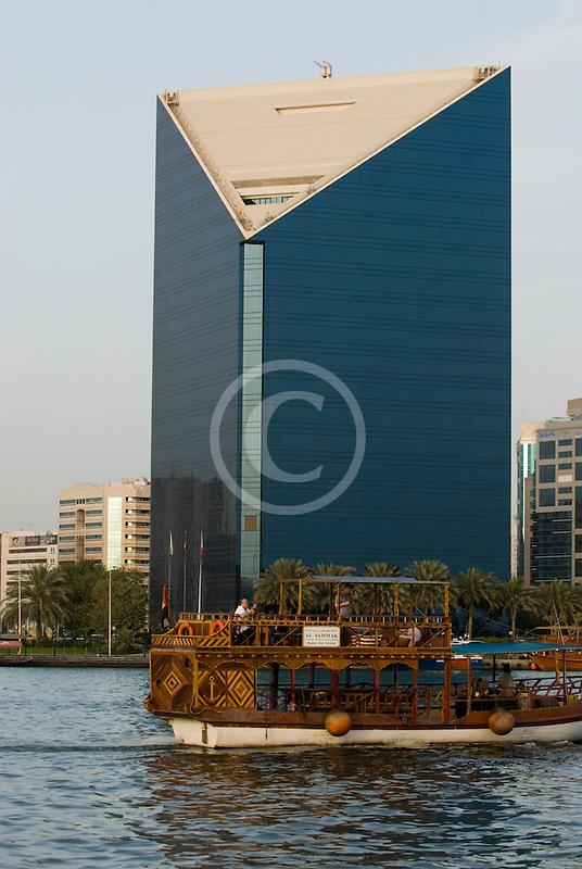 United Arab Emirates, Dubai, Deira skyline and abra ferry on Dubai Creek