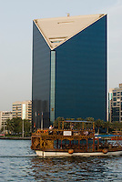 United Arab Emirates, Dubai, Deira skyline and abra ferry on Dubai Creek