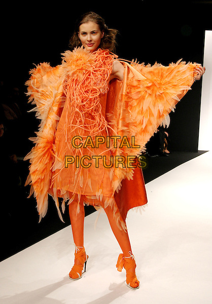 MODEL.Erin Setherston's Spring/ Summer Haute Couture Collection 2005 Fashion Show, Paris, .January 24th 2005..full length orange ruffle feather dress tights catwalk.**UK SALES ONLY**.Ref: MDS.www.capitalpictures.com.sales@capitalpictures.com.©Virgille Biechy/O.Medias/Capital Pictures .