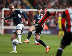 George Saville of Millwall  tackled by David Brooks of Sheffield Utd during the championship match at the Bramall Lane Stadium, Sheffield. Picture date 14th April 2018. Picture credit should read: Simon Bellis/Sportimage