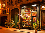 Flower shop at night in Paris, France