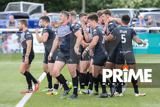 Alex Walker of London Broncos (2nd right) celebrates with team mates after he scores a try during the Kingstone Press Championship match between London Broncos and Featherstone Rovers at Castle Bar , West Ealing , England  on 25 June 2017. Photo by David Horn.