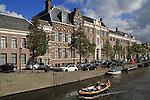Boat on canal on way to train station, Haarlem, Netherlands