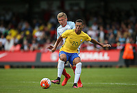 Richarlison of Brazil holds off Taylor Moore (Bristol City) of England during the International match between England U20 and Brazil U20 at the Aggborough Stadium, Kidderminster, England on 4 September 2016. Photo by Andy Rowland / PRiME Media Images.