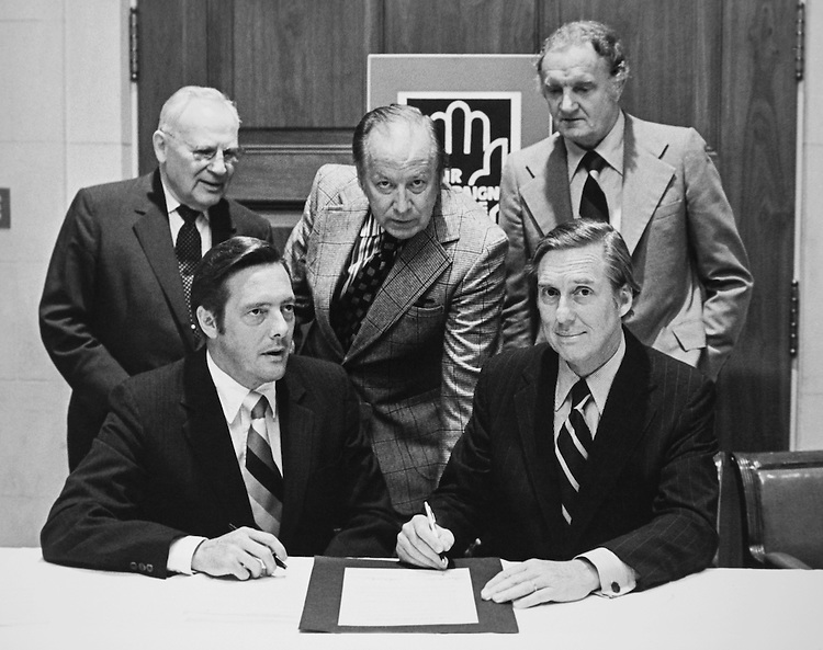 Sen. Lloyd Bentsen, D-Tex signing document. (Photo by Dev O'Neill/CQ Roll Call)