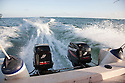 Boat with two outboard motors traveling at speed in Malaysia.