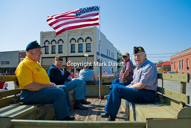 Clarence Walk, Ray Heisner, Larry Bowlin and Robert Davey ride in a 1943 WC63 personnel carrier owned by Mike Bowlin.