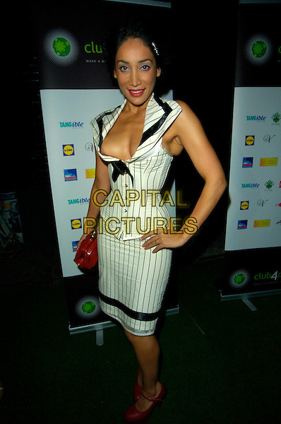 SOPHIA HYATT.The Club for Climate launch party, Studio Valbonne bar & nightclub, London, England..September 6th, 2007.full platform shoes length white dress top skirt black pinstripe red cleavage bag purse hand on hip.CAP/CAN.©Can Nguyen/Capital Pictures
