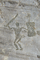 Petroglyph, rock carving, of a warriors with a shield and sword. Carved by the ancient Camunni people in the iron age between 1000-1200 BC. Rock no 24, Foppi di Nadro, Riserva Naturale Incisioni Rupestri di Ceto, Cimbergo e Paspardo, Capo di Ponti, Valcamonica (Val Camonica), Lombardy plain, Italy