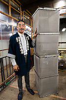 "Tokubee Masuda, CEO of the Tsukinokatsura sake brewery with a metal cage used to make ""nigori"" cloudy sake. Fushimi, Kyoto, Japan, October 10, 2015. Tsukinokatsura Sake Brewery was founded in 1675 and has been run by 14 generations of the Masuda family. Based in the famous sake brewing region of Fushimi, Kyoto, it has a claim to be the first sake brewery ever to produce ""nigori"" cloudy sake. It also brews and sells the oldest ""koshu"" matured sake in Japan."