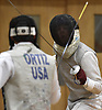 Michael DeSando of Ward Melville, right, battles Zachary Ortiz of Garden City in the Brentwood Holiday Tournament's boys foil final at Brentwood High School on Saturday, Dec. 15, 2018.