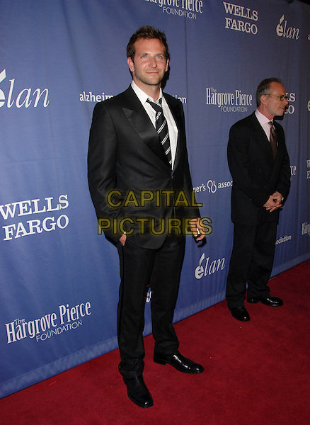 "BRADLEY COOPER.The 15th Annual ""A Night at Sardi's"" Fundraiser and Awards held at The Beverly Hilton Hotel in Beverly Hills, California, USA..March 7th, 2007.full length black suit .CAP/DVS.©Debbie VanStory/Capital Pictures"