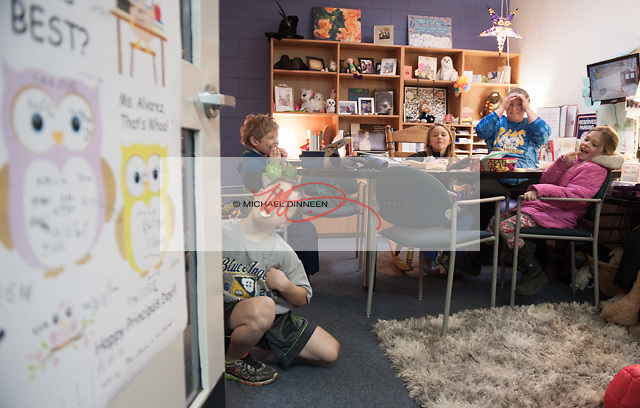 Chugiak Elementary third grader Samson Young, left, masquerades as a duck during lunch on Principal Appreciation Day with s surprised principal Sarah Alvarez.   Also with the principal are from left, Alexander Davison, Taylor Mantyla and Sabrina Otts.  Photo for the Star by Michael Dinneen