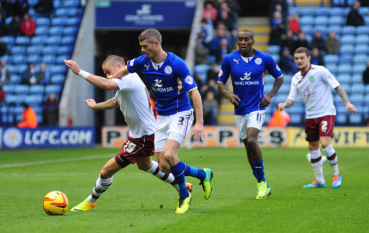 Burnley's Michael Kightly vies for possession with Leicester City's Paul Konchesky <br /> <br /> Photo by Chris Vaughan/CameraSport<br /> <br /> Football - The Football League Sky Bet Championship - Leicester City v Burnley - Saturday 14th December 2013 - King Power Stadium - Leicester<br /> <br /> &copy; CameraSport - 43 Linden Ave. Countesthorpe. Leicester. England. LE8 5PG - Tel: +44 (0) 116 277 4147 - admin@camerasport.com - www.camerasport.com