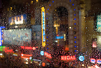 AVAILABLE FOR LICENSING FROM WWW.PLAINPICTURE.COM.  Please go to www.plainpicture.com and search for image # p5690246.<br /> <br /> 42nd Street Near Times Square Viewed Thru a Window in the Rain, Midtown Manhattan, New York City, New York State, USA