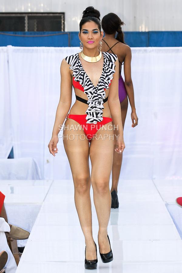 Model walks runway in an AdianiC Spring 2013 swimsuit by Adisa Imani Christopher, during the JRG Bikini Under The Bridge 2012 fashion show on July 9, 2012.