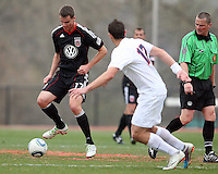 Conor Shanosky (17) of D.C. United pushes the ball away from Hunter Jumper (17) during a scrimmage against the University of Virginia at Ludwig Field, University of Maryland, College Park, on April  10 2011. D.C. United won 1-0.