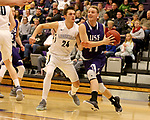 SIOUX FALLS, SD - DECEMBER 31: Zach Wessels #11 from the University of Sioux Falls drives to the basket past Steven Schaefer #24 from Augustana University during their game Sunday afternoon December 31, 2017 at the Stewart Center in Sioux Falls, SD.  (Photo by Dave Eggen/Inertia)