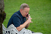 White House Press Secretary Sean Spicer has a private phone call as United States President Donald J. Trump and first lady Melania Trump host the annual Congressional Picnic on the South Lawn of the White House in Washington, DC on Thursday, June 22, 2017.<br /> Credit: Ron Sachs / CNP