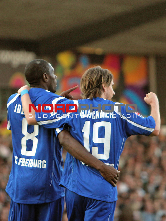 2.Liga FBL 2008/2009  29.Spieltag R&uuml;ckrunde<br /> FC St.Pauli vs. SC Freiburg 1:2<br /> <br /> Bj&ouml;rn Brunnemann (Nr.5) und Mohamadou Idrissou (Nr.8).<br /> <br /> <br /> <br /> Foto &copy; nph (nordphoto)<br /> <br /> *** Local Caption ***