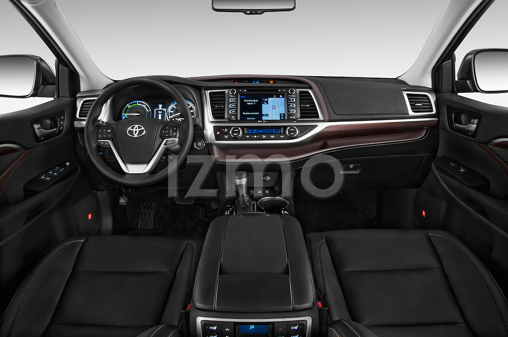 Stock photo of straight dashboard view of a 2015 Toyota Highlander Limited Hybrid 4x4 5 Door SUV Dashboard