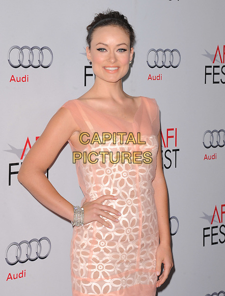 "Olivia Wilde.AFI Fest 2011 Premiere Of ""Butter"" held at Grauman's Chinese Theatre, Hollywood, California, USA..November 6th, 2011.half length dress pink white beige sheer white hand on hip silver bracelet                         .CAP/RKE/DVS.©DVS/RockinExposures/Capital Pictures."