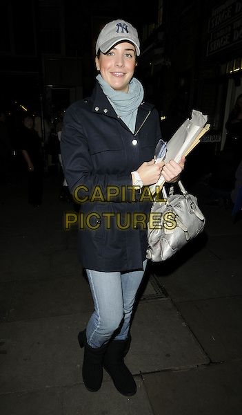 "GEMMA ATKINSON .Leaving the theatre after performing in ""Calendar Girls"", Noel Coward Theatre, London, England, UK, .October 30th 2009..full length cap hat black coat jeans boots bag blue scarf grey gray silver .CAP/CAN.©Can Nguyen/Capital Pictures"