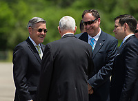 In this photo released by the National Aeronautics and Space Administration (NASA) United States Vice President Mike Pence greets Acting NASA Administrator Robert Lightfoot, second from right, and Director, Kennedy Space Center, Robert Cabana, left, after arriving at the Shuttle Landing Facility (SLF) to highlight innovations made in America and tour some of the public/private partnership work that is helping to transform Kennedy Space Center (KSC) into a multi-user spaceport on Thursday, July 6, 2017 in Cape Canaveral, Florida.  Photo Credit: Aubrey Gemignani/NASA/CNP/AdMedia