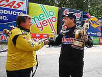 May 17, 2015; Commerce, GA, USA; Troy Coughlin Sr (left) congratulates NHRA pro mod driver Kenny Lang celebrates after winning the Southern Nationals at Atlanta Dragway. Mandatory Credit: Mark J. Rebilas-USA TODAY Sports