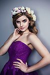 young blonde woman in purple dress and a flower crown looking sassy