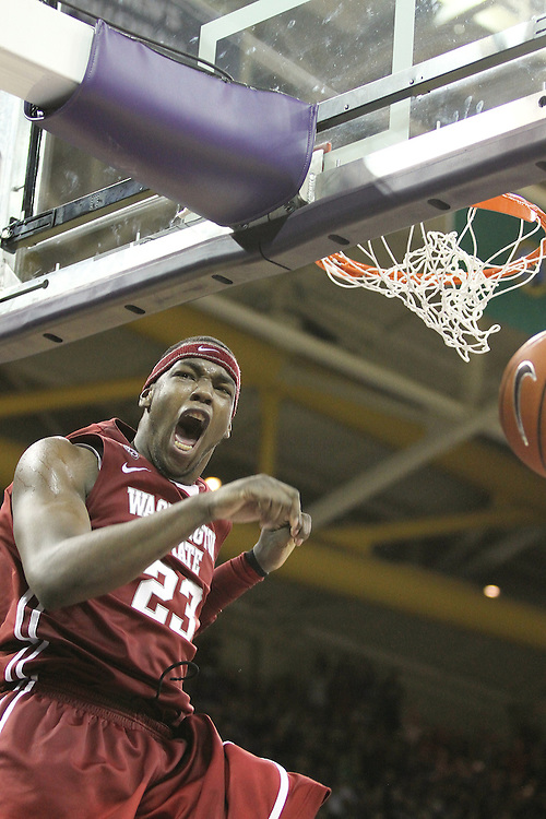 DeAngelo Casto, Washington State junior forward, reacts while finishing off a dunk during the Cougars 80-69 road victory over arch-rival Washington at the Alaska Airlines Arena in Seattle, Washington, on February 27, 2011.  Casto had a double-double in the contest, with 20 points and 13 rebounds.  With the victory, Casto and the Cougars swept the regular season series from the Huskies, two games to none.