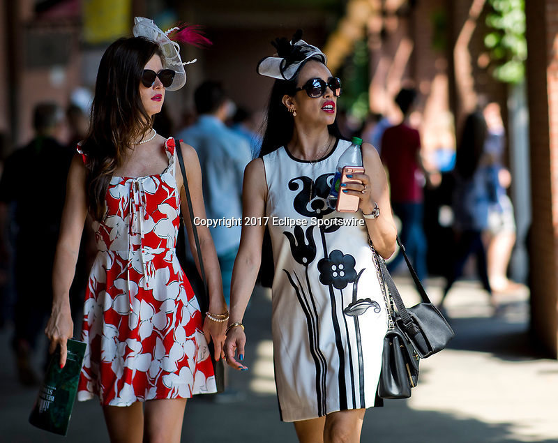 ELMONT, NY - JUNE 10: Two women walk to the grandstand on Belmont Stakes Day at Belmont Park on June 10, 2017 in Elmont, New York (Photo by Scott Serio/Eclipse Sportswire/Getty Images)