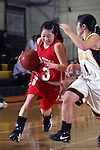 Palos Verdes, CA January 19, 2010 - Jaclyn Oka (3) forces her way to the hoop as Peninsula's Shelby Tsukamoto (11) defends her during the Palos Verdes vs Peninsula Panthers basketball game at Peninsula High School.