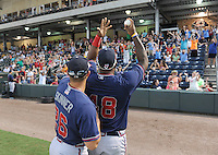 Infielder William Beckwith (48) and outfielder Will Skinner (26) of the visiting Rome Braves play catch with members of the crowd during a lengthy rain delay before a game against the Greenville Drive on July 5, 2012, at Fluor Field at the West End in Greenville, South Carolina. The game eventually was postponed due to rain. (Tom Priddy/Four Seam Images)