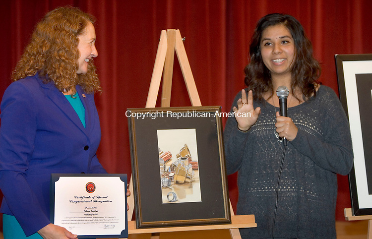 WATREBURY CT. 03 May 2015-050315SV03-Rep. Elizabeth H. Esty, D-5th District, awards Liliana Sanchez, 17, of Wilby High as the 1st place winner of this year's Congressional Art Competition hosted by the congresswoman at Mattatuck Museum in Waterbury Sunday. Liliana&rsquo;s artwork will hang in the U.S. Capital. <br /> Steven Valenti Republican-American