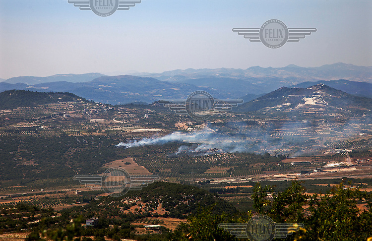 Syrian army burn forested land in the Jebel Akrad Mountains to wipe out cover on the ground for the Free Syrian Army (FSA). A highly strategic region, the mountains shadow the main communication routes that lead from the coastal city of Latakia inland.