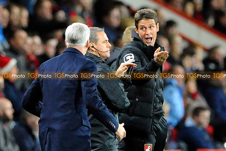 The fourth official Brendan Malone steps between AFC Bournemouth Assistant Manager Jason Tindall right and Crystal Palace Manager Alan Pardew as they have an exchange of words during AFC Bournemouth vs Crystal Palace at the Vitality Stadium