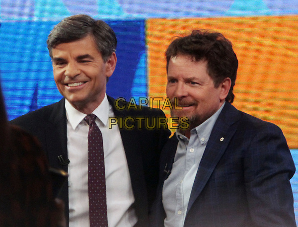 NEW YORK, NY - APRIL 4: George Stephanopolous with Michael J. Fox at ABC's Good Morning America on April 4, 2018. <br /> CAP/MPI/RW<br /> &copy;RW/MPI/Capital Pictures