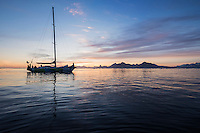 Reflection of sailboat in calm waters near Tasiilaq, east Greenland