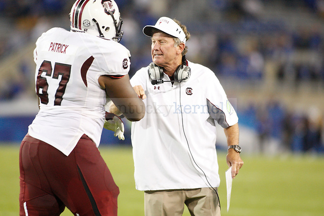 Head coach Steve Spurrier fist bumps South Carolina Gamecocks guard Ronald Patrick (67) during the second half of the University of Kentucky football vs.  South Carolina at Commonwealth Stadium in Lexington, Ky., on Saturday, September 29, 2012. Photo by Tessa Lighty | Staff