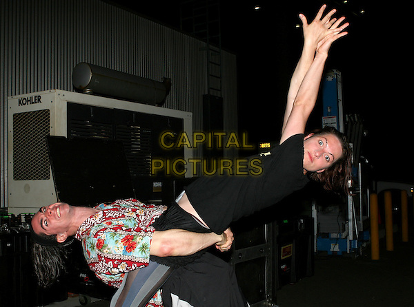 AMANDA PALMER & BRIAN VIGLIONE OF THE DRESDEN DOLLS.backstage at The Grove in Anaheim, California, USA, July 31st 2006..half length funny hands gestures pose arms up around waist holding bending.**Exclusive**.Ref: DVS.www.capitalpictures.com.sales@capitalpictures.com.©Debbie VanStory/Capital Pictures