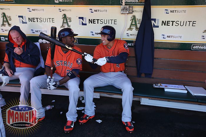 OAKLAND, CA - APRIL 19:  Dexter Fowler #21 and George Springer #4 of the Houston Astros goof around in the dugout before the game against the Oakland Athletics at O.co Coliseum on Saturday, April 19, 2014 in Oakland, California. Photo by Brad Mangin