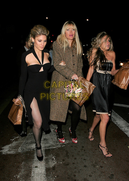 HOFIT GOLAN, CAPRICE BOURRET & NIKKI GRAHAME .Duncan James' Birthday Party, Pigalle Club, Picadilly, London, England..April 8th, 2008.full length bourett black halterneck dress funny face cold chilly slit split brown tweed coat brown paper bag tights .CAP/AH.©Adam Houghton/Capital Pictures.