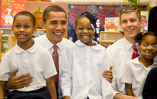 Chicago, IL - December 16, 2008 -- United States President-elect Barack Obama and newly nominated Secretary of Education former Chicago School Chief Arne Duncan pose for a photo with first to fourth graders at Dodge Renaissance Academy on Chicago's West Side..Credit: Ralf-Finn Hestoft - Pool via CNP