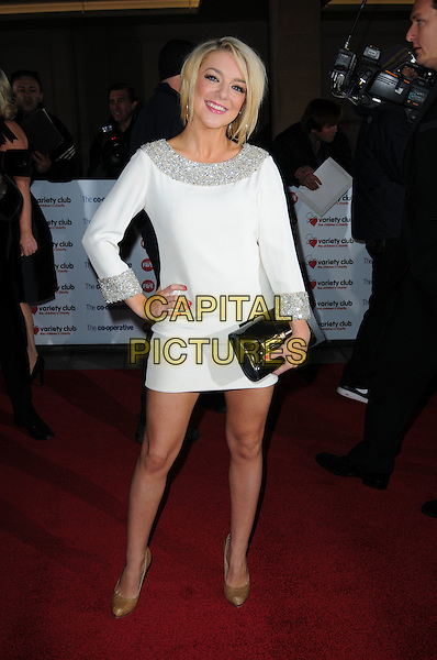 SHERIDAN SMITH .The Co-operative Variety Club Showbiz Awards, Grosvenor House Hotel, Park Lane, London, England, UK, .14th November 2010. .full length white dress hand on hip long sleeve silver beaded beige shoes clutch bag embellished neckline cuffs .CAP/CAS.©Bob Cass/Capital Pictures.