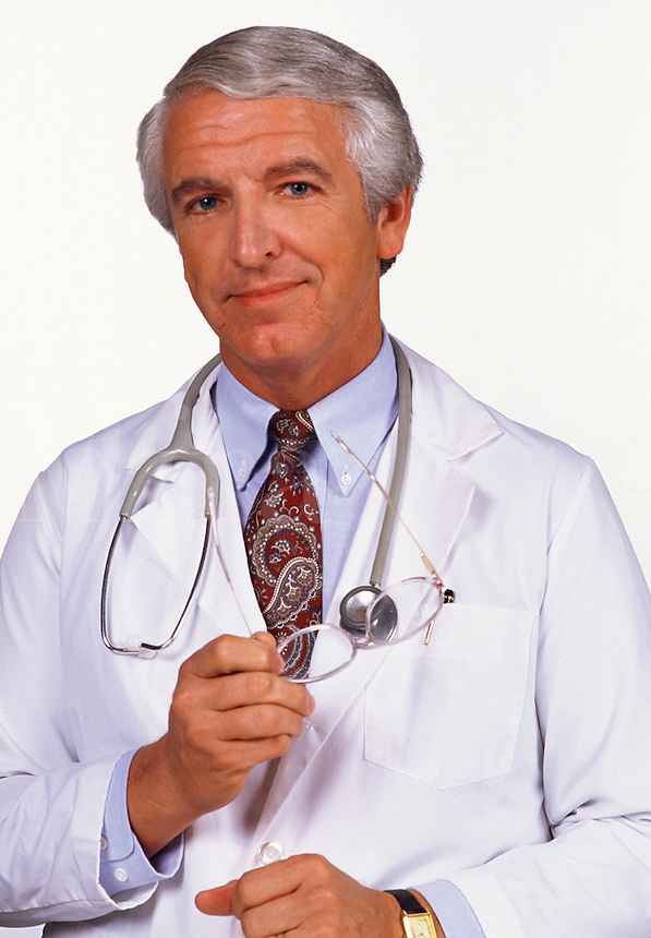 Portrait of a male medical doctor with glasses and stethoscope.