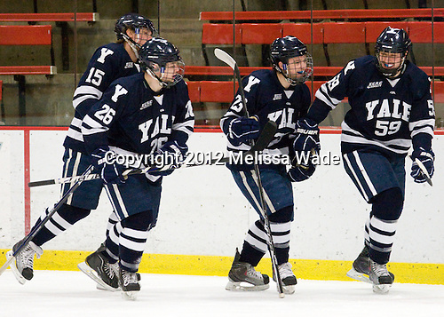Clinton Bourbonais (Yale - 15), Nicholas Weberg (Yale - 26), Kevin Peel (Yale - 23) and Chad Ziegler (Yale - 59) celebrate Ziegler's game. - The Harvard University Crimson defeated the visiting Yale University Bulldogs 8-2 in the third game of their ECAC Quarterfinal matchup on Sunday, March 11, 2012, at Bright Hockey Center in Cambridge, Massachusetts.