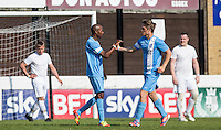 Dan Olsen (Singer)(right) of Celeb FC congratulates Steve Slade of Celeb FC on his goal during the 'Greatest Show on Turf' Celebrity Event - Once in a Blue Moon Events at the London Borough of Barking and Dagenham Stadium, London, England on 8 May 2016. Photo by Andy Rowland.